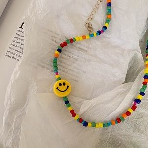 Urban outfitters smiley face rainbow beaded choker